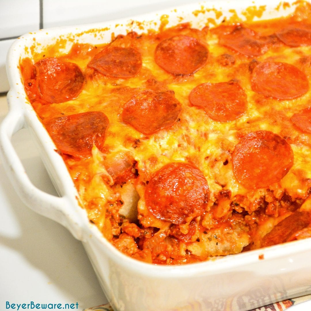 Bubble-Up pizza casserole is an easy weeknight meal since the casserole is made with Grands biscuits, spaghetti sauce, and your favorite pizza toppings.
