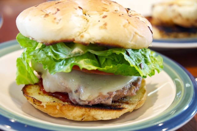 Bacon cheeseburgers on onion buns