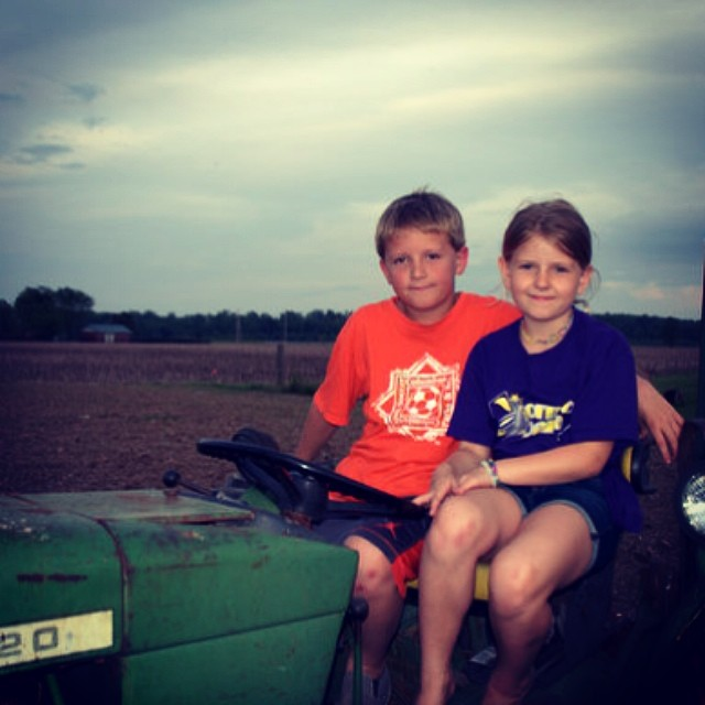 Kids sitting on a tractor