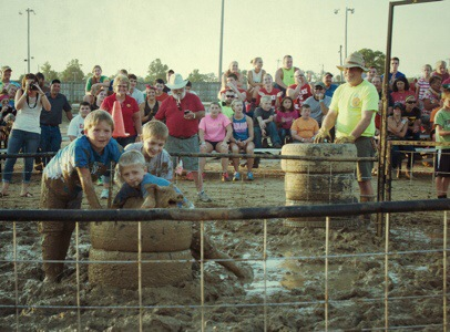 Fun In The Greased Pig Contest