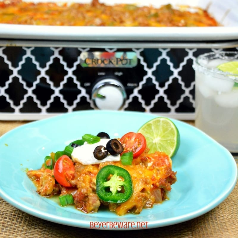 Crock Pot Low-Carb Taco Lasagna is full of ground pork or beef, cheese, salsa, onions and peppers for a satisfying and flavorful meal for people following a #Keto or low- carb diet plan. #Lowcarb #Lasagna