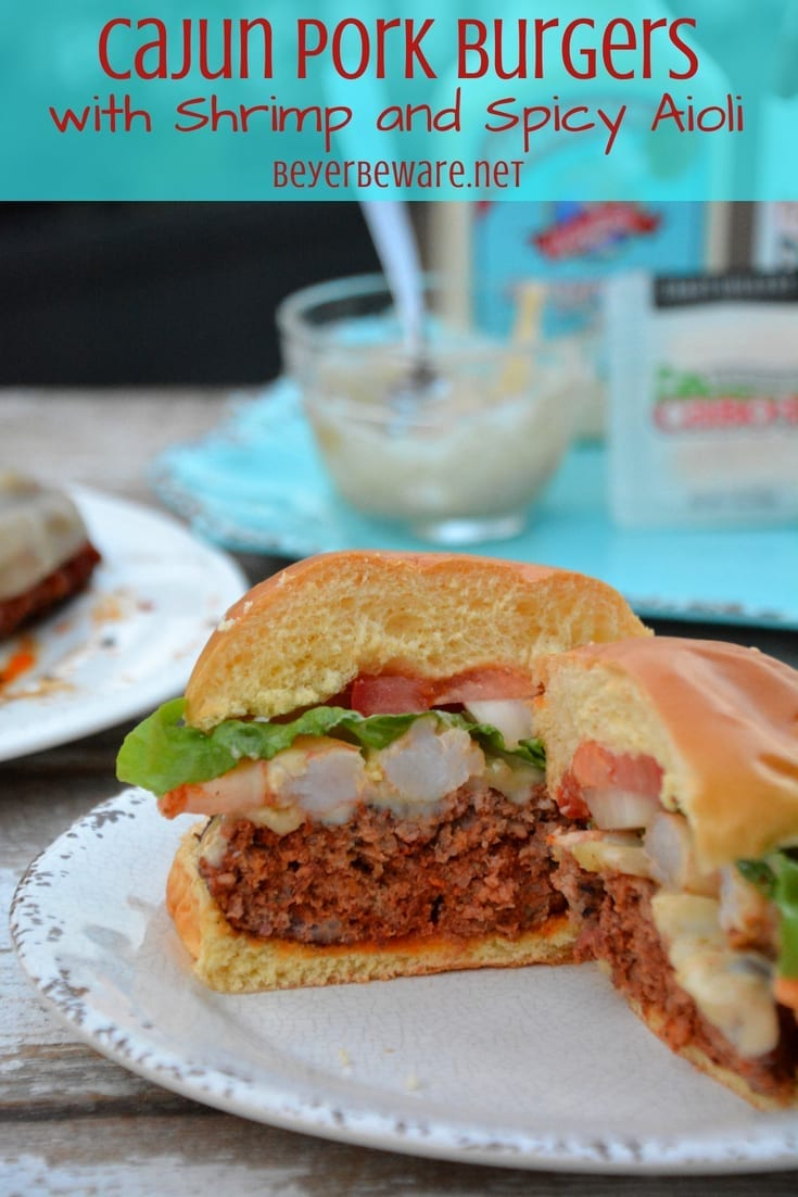 The Cajun pork burgers topped with shrimp and then drenched in a Cajun aioli combine ground pork, chorizo, with a Cajun seasoned horseradish mayonnaise for a perfect surf and turf burger recipe.