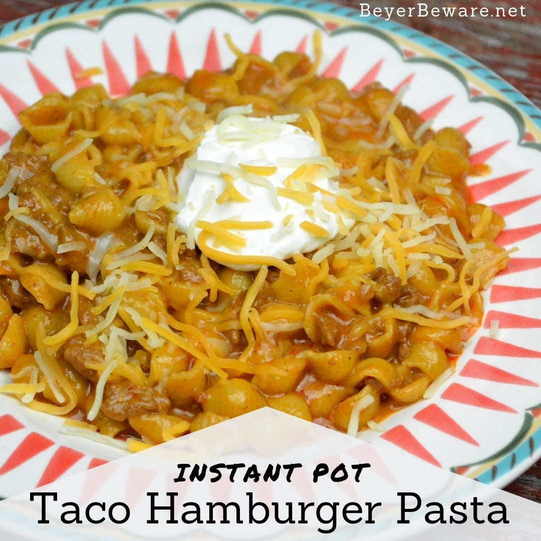 Instant Pot Taco Hamburger Pasta is the 15-minute homemade Hamburger Helper with just five ingredients creating a taco flavored cheesy taco beef and shells. #InstantPot #Hamburger #HamburgerHelper #Beef #EasyDinners