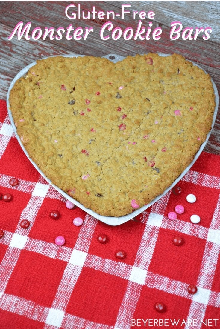 Gluten-Free Monster Cookie barsare a flourless bar cookie recipe combining peanut butter, oats, chocolate chips, and M & Ms to create a chewy chocolate cookie treat. #GlutenFree #Peanutbutter #Chocolate #GlutenFreeDessert #BarCookies