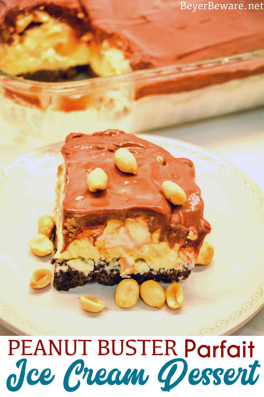 Peanut buster parfait ice cream dessert is a 13X9 ice cream cake with layers of crushed Oreos, vanilla ice cream, peanuts, and homemade chocolate sauce.