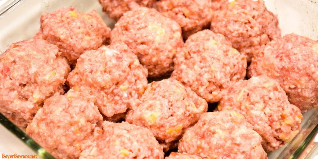 Bourbon Glazed Ham Balls are a pork lovers dream with the combination of ground ham and ground pork along with onion, crackers, and egg combine with my pork seasoning and drenched in a sweet bourbon glaze for the best pork meatball around.