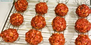 Bacon cheeseburger stuffed meatballs on the grill are the perfect grilled meatball made with bacon bits, fried onions, ground beef, and a cube of Colby jack cheese.