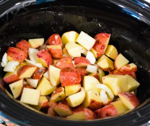 Ranch potatoes in the crock pot for the bed to put the pork loin roast on.