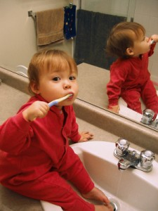 Child brushing teeth on beyondattitude.com