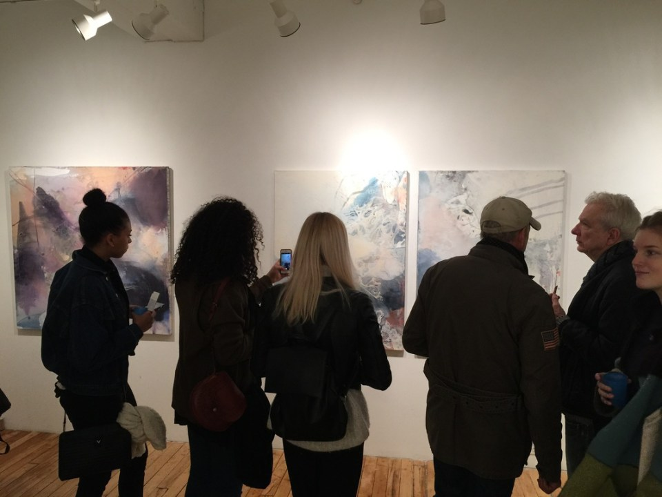 Audience looking at Huo Dongze's work at Phenix Gallery