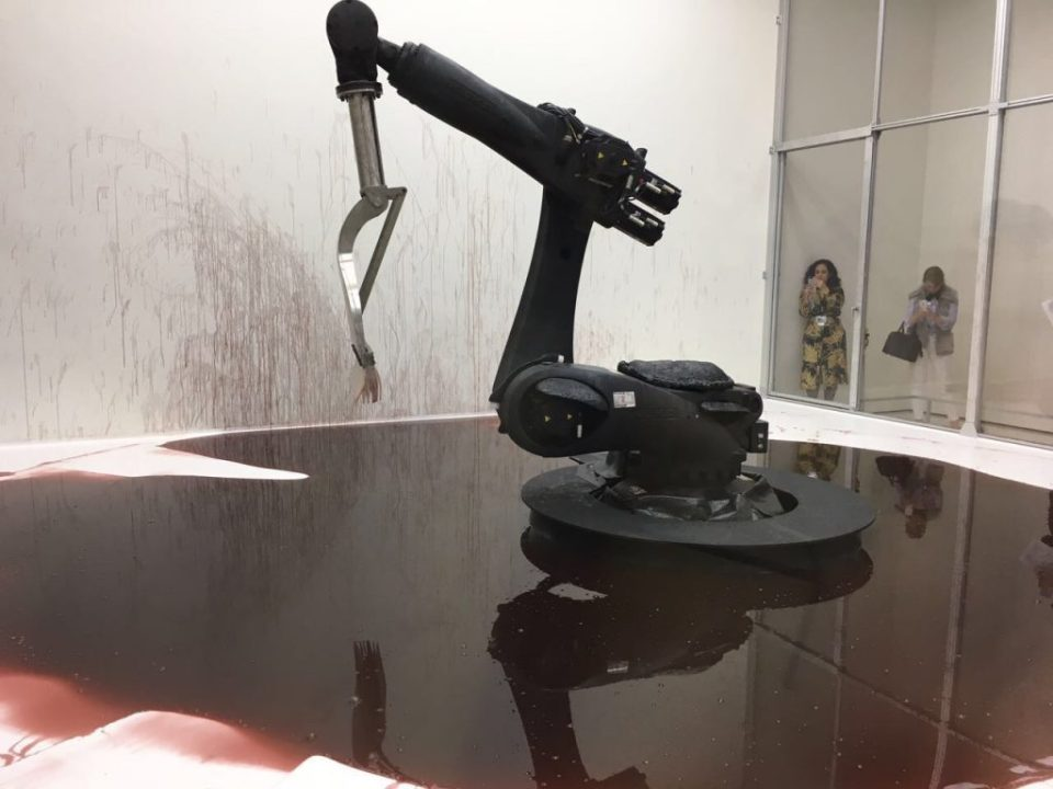 Sun Yuan and Peng Yu - 'Can't Help Myself', 2016. Kuka industrial robot, stainless steel and rubber, cellulose ether in colored water, lighting grid with Cognex visual recognition sensors, and polycarbonate wall with aluminum frame.