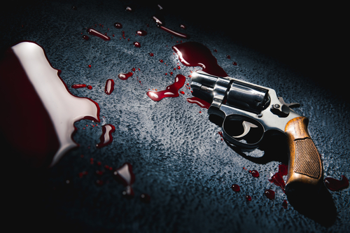 crime scene concept with a gun on a blood puddle, high contrast image