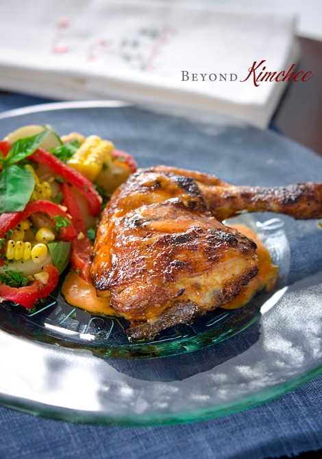 Portuguese Peri-Peri Chicken is grilled and served extra sauce and salad