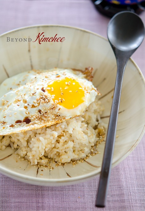 Plain rice is topped with fried egg, soy sauce, butter, sesame oil, and sesame seeds.