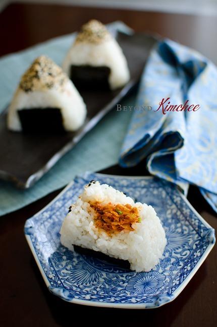 These rice patties are stuffed with kimchi and tuna, similar to Japanese Onigiri