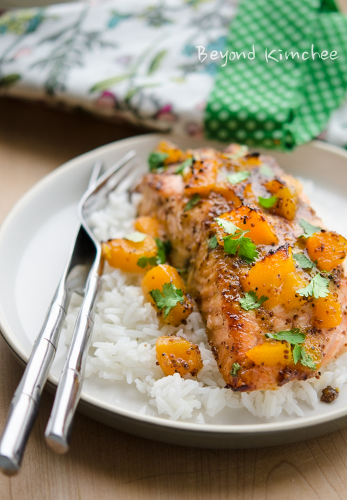Salmon fillet is baked with mustard and peach glaze and served with rice.