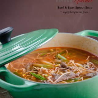 Beef and bean sprouts are simmered together in a spicy a soup with Korean chili flakes.