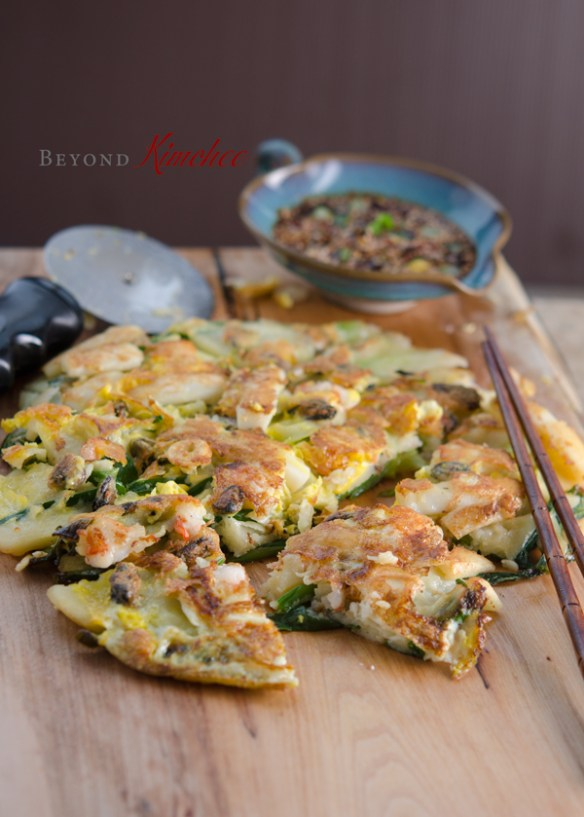 Korean scallion pancakes are served with dipping sauce.