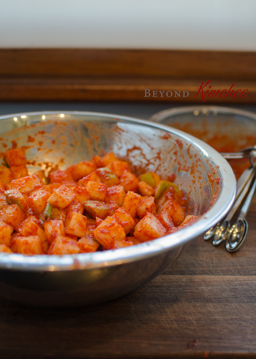 Korean radish kimchi is tossed with kimchi chili seasoning paste.