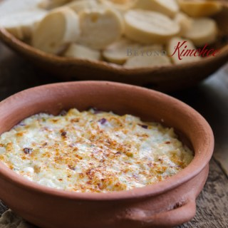 Warm hearts of palm dip served with baguette slices
