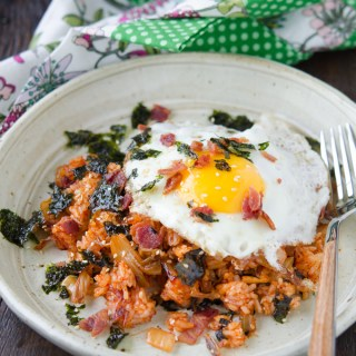 Kimchi Bacon Fried Rice is topped with a fried egg and seaweed