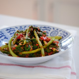 Turnip Green Kimchi are made with fresh red chili and fermented