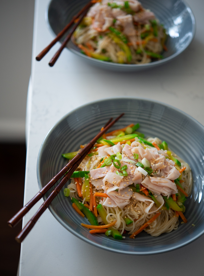 One Pot Korean Noodles and Vegetables are topped with lunch ham slices