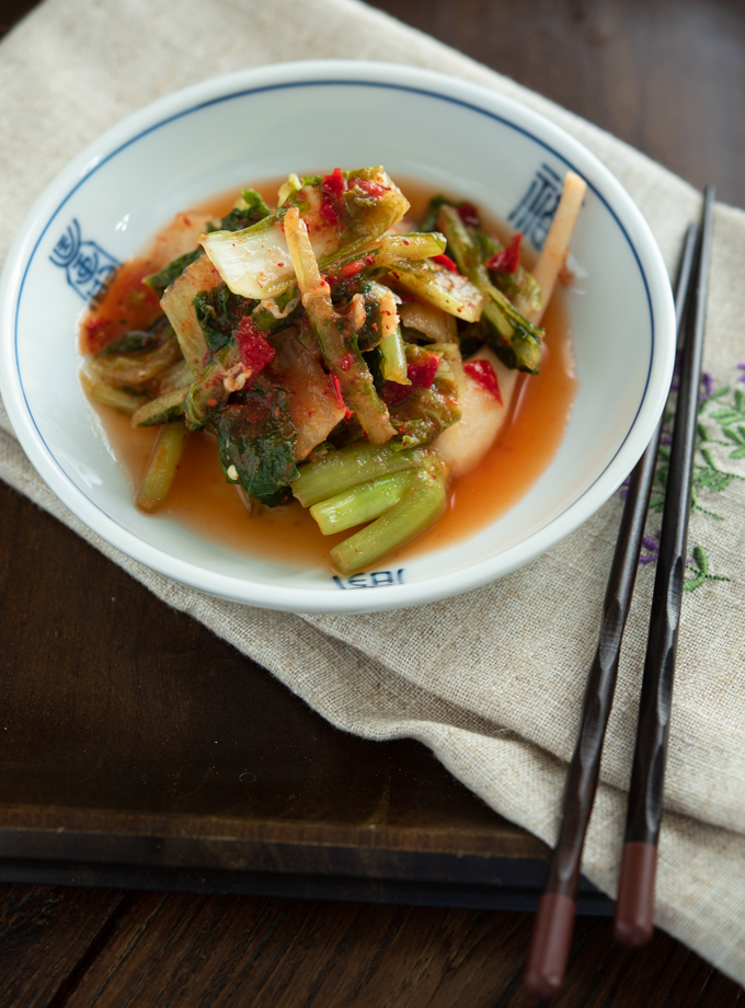 Homemade young cabbage kimchi with radish is fermented.