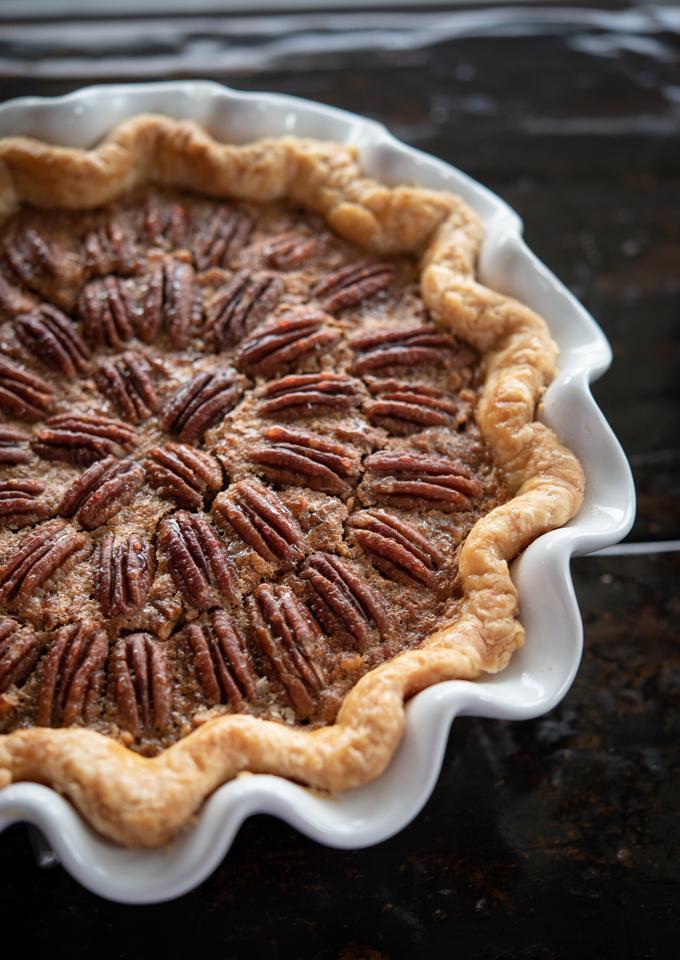 Pecan pie is decorated with pecan halves on top