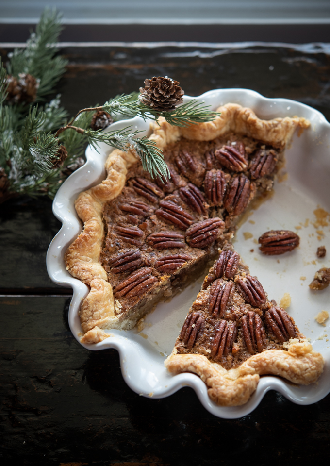 Pecan Pie is baked in a white fluted pie pan
