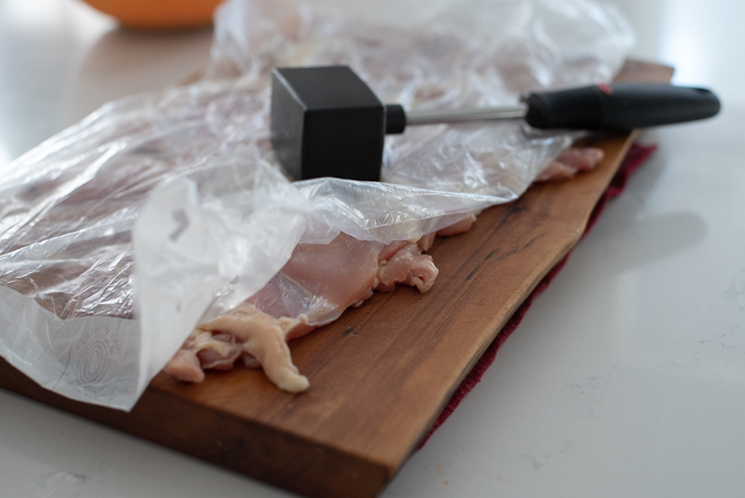 Pound chicken with a meat hammer to tenderize
