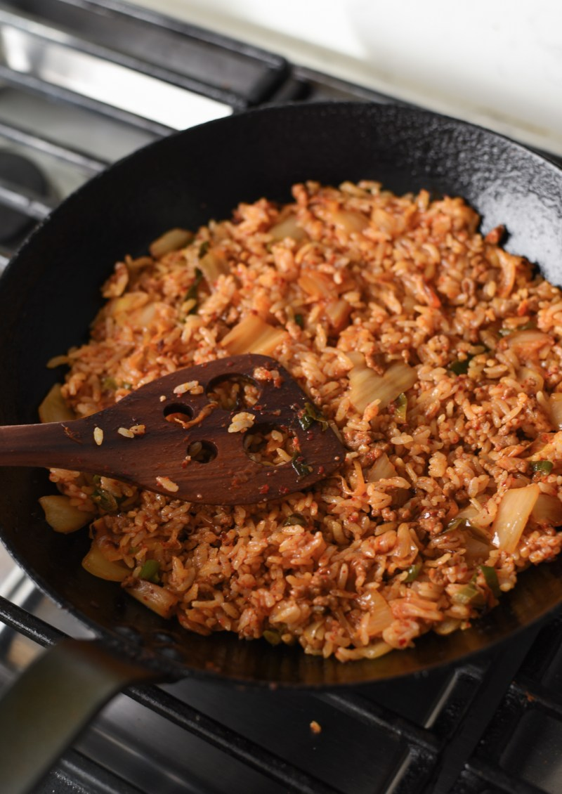 press kimchi fried rice gently to the cottom of a skillet