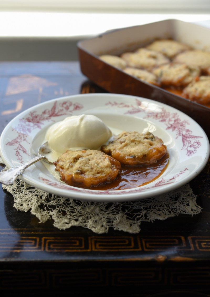Enjoy date dumplings with a scoop of vanilla ice cream of whipped cream