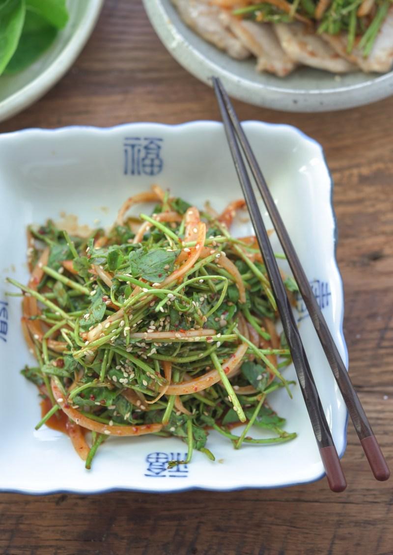 Minari, aka water celery or water dropswort, is dressed with Korean chili vinaigrette