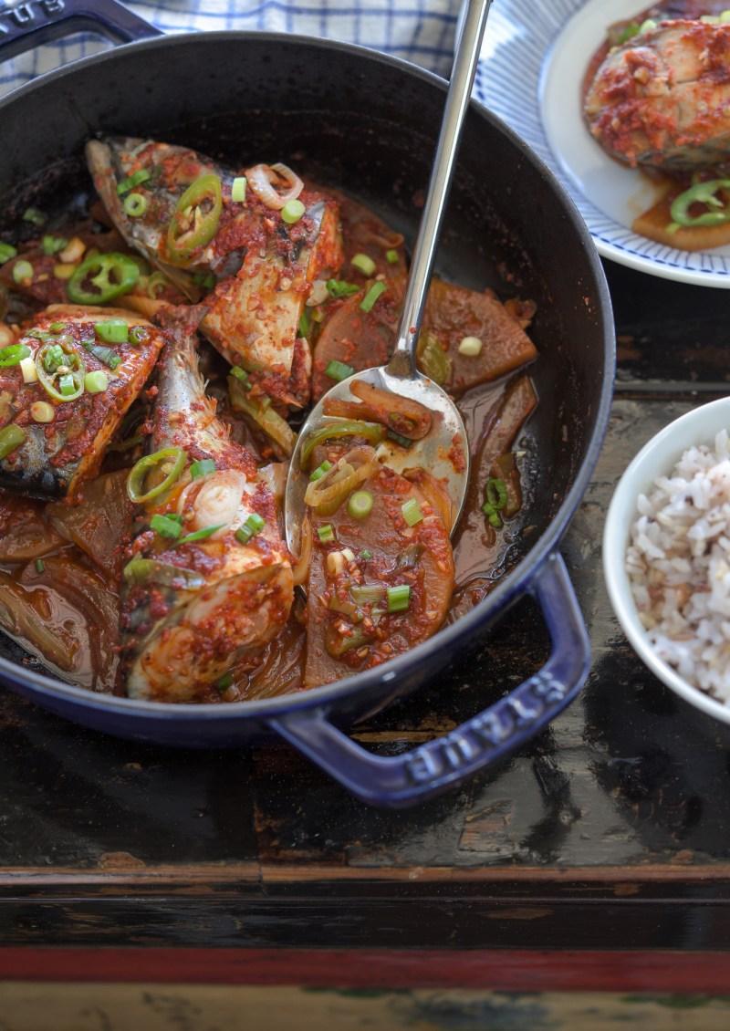 Fresh mackerel fish is braised with Korean radish in chili sauce