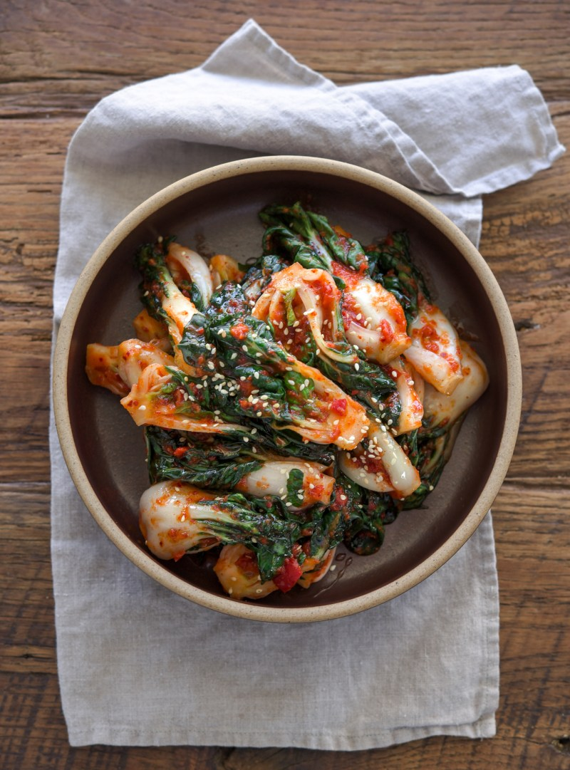 Bok choy kimchi is made with fresh red chili and apple onion puree.