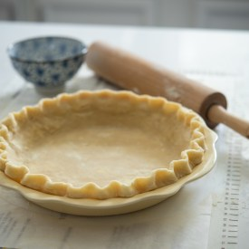 Lard and Butter Pie Crust is fluted on a 9-inch pie pan