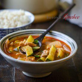 Serve spicy Korean pork and zucchini stew with rice