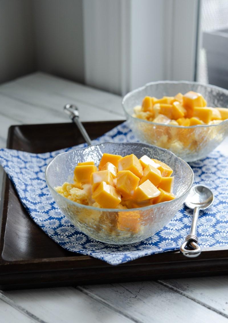Homemade milky shaved ice (bingsu) is topped with fresh mango