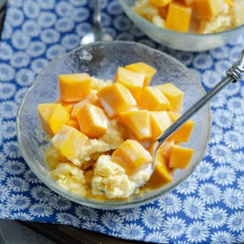 Homemade mango shaved ice (bingsu) is made in a blender and topped with fresh mango