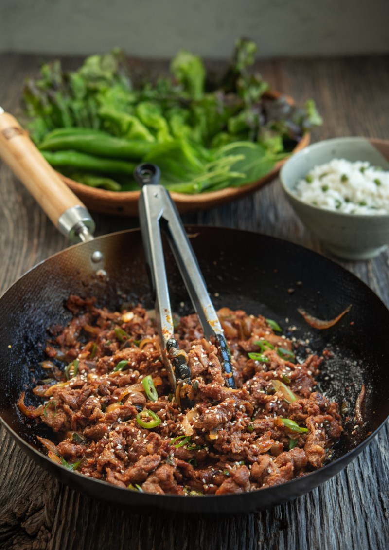 Stir-fried spicy Korean pork goes well with rice and lettuce.