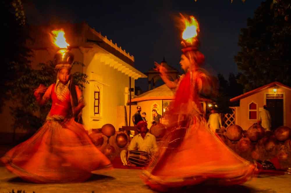 Women dancing at Jaipur tourist village