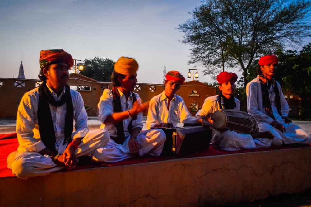 Musicians playing instruments Jaipur tourist village