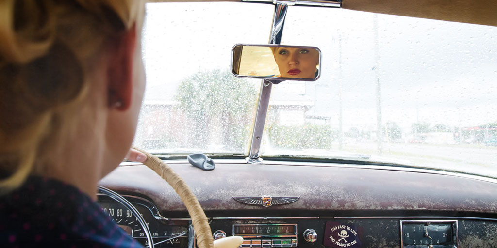 Hawaii Conceptual Portrait pinup photography womans reflection in rear view mirror