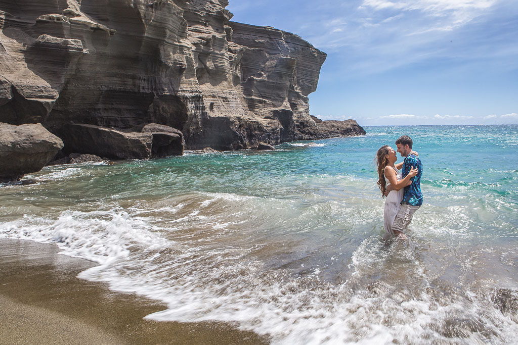 Hawaii Portrait engagement photos green sand beach laughing couple in waves professional photographer