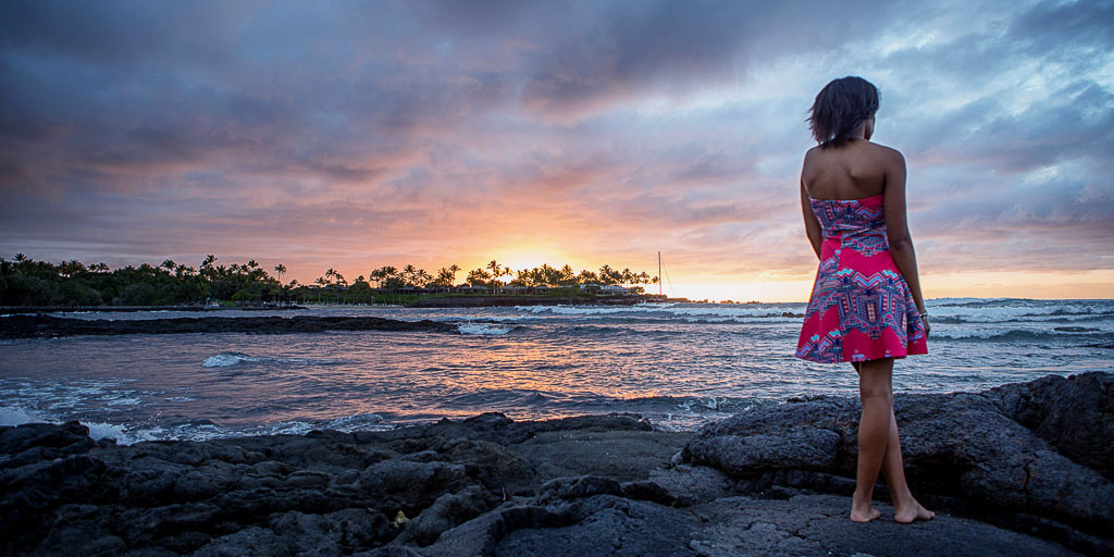 Hawaii Portrait woman looking out to ocean sunset mauna lani resort kona