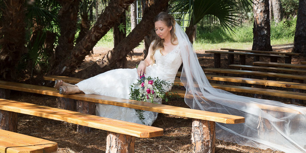 Hawaii professional photographer bride with bouquet rustic bench