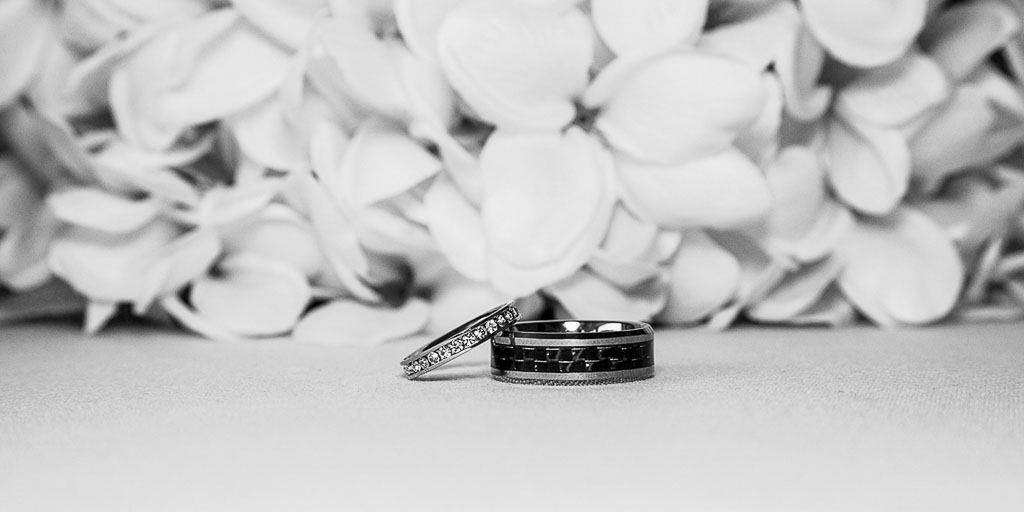 Hawaii wedding black and white wedding ring with plumeria
