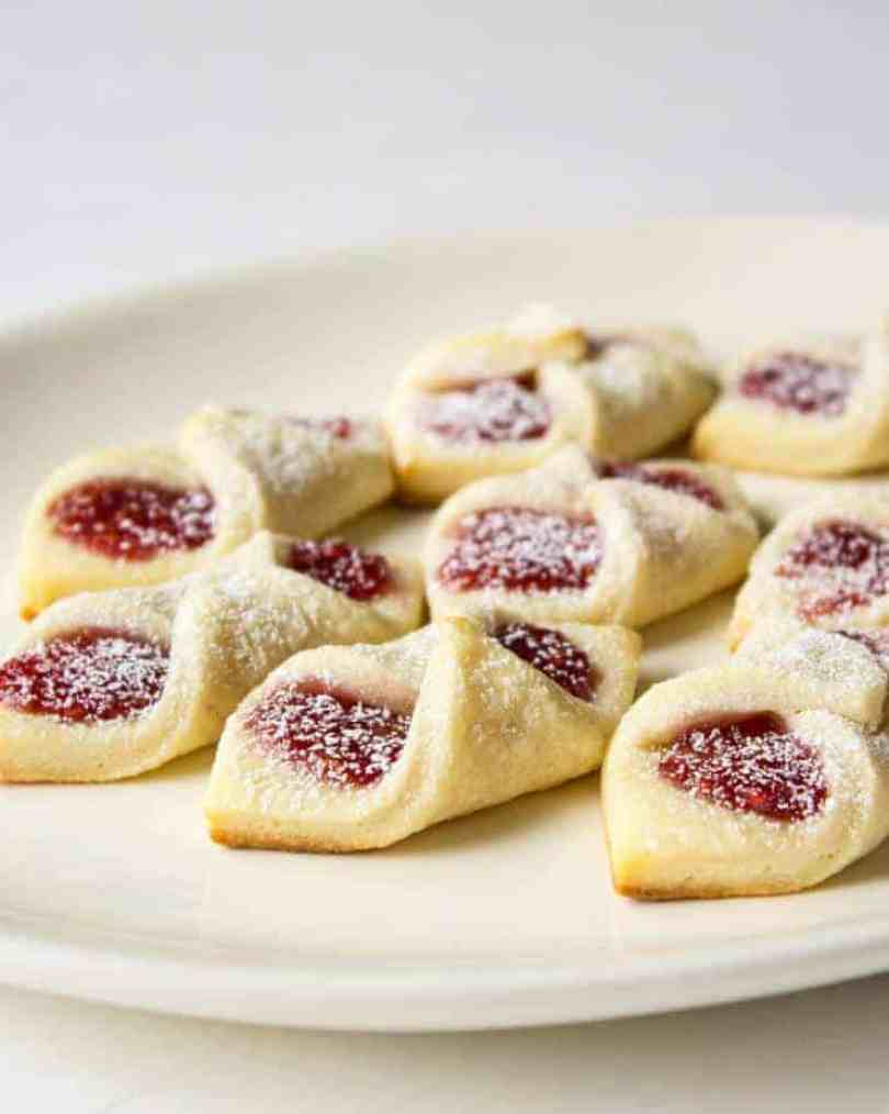 A plate full of Raspberry Bow Tie Cookies
