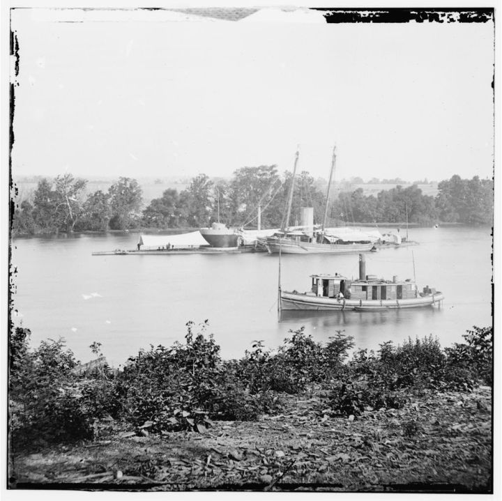 James River, Va. U.S.S. monitor Canonicus taking on coal from a schooner